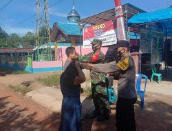 Bhabinkamtibmas dan Babinsa Desa Maragut Bersama Gencarkan Giat PPKM
